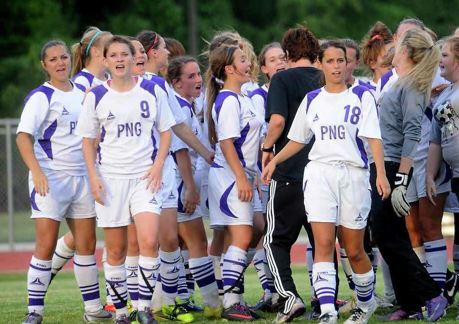 The PN-G girls soccer team celebrates a playoff win against Willis at Kingwood Park High School in Kingwood, Tuesday, April 3, 2012. Tammy McKinley/The Enterprise Photo: TAMMY MCKINLEY