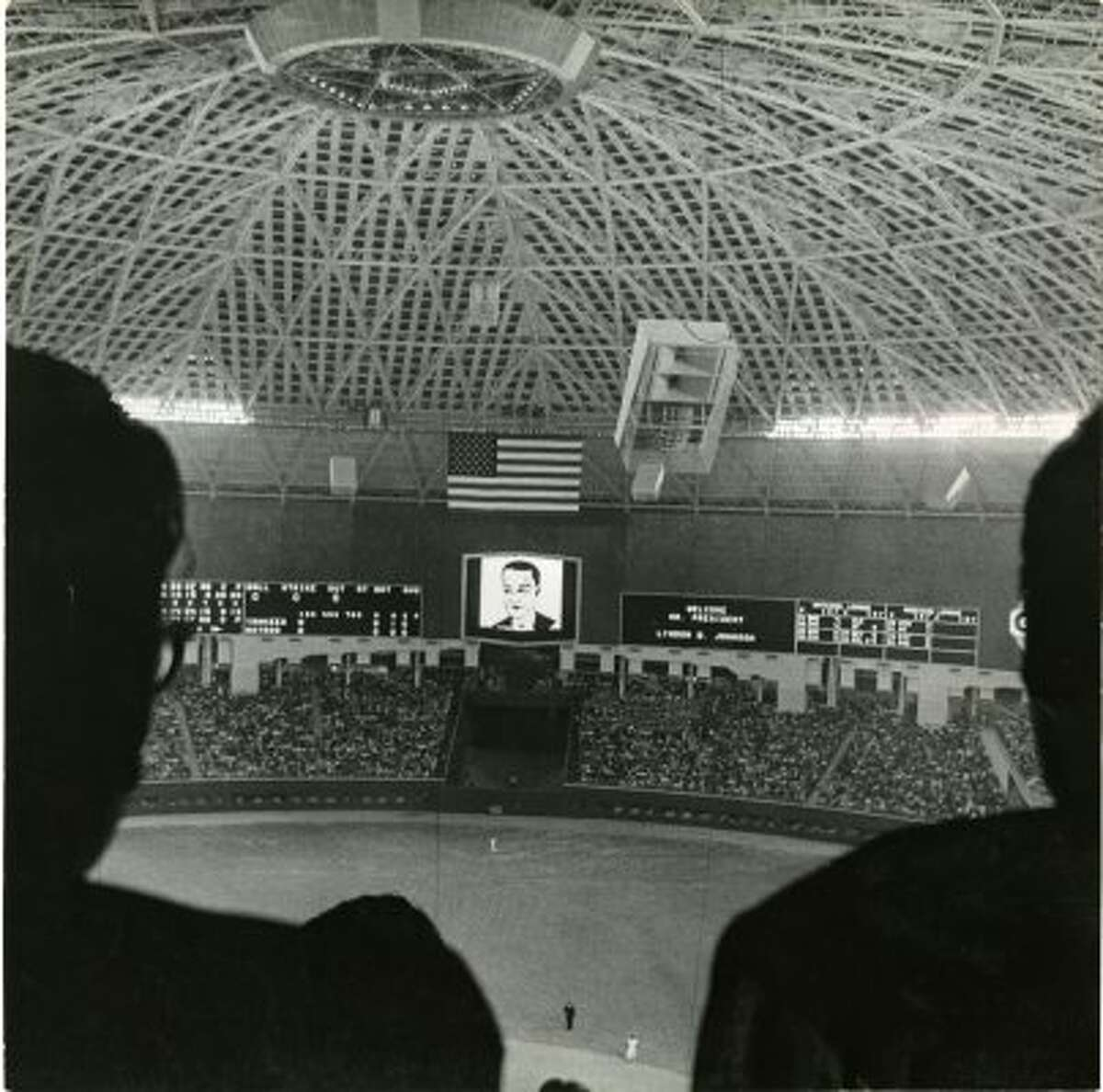 The Astrodome scoreboard lit up in 1965 to welcome President Lyndon Baines Johnson to the world's first indoor baseball game. (Curtis McGee / Houston Chronicle)