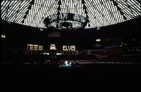 Elvis Presley performs at the 1970 Houston Livestock Show and Rodeo in the Astrodome.  (Fred Bunch / Houston Chronicle)