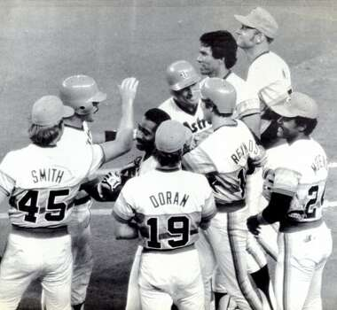 Houston Astro Craig Reynolds is congratulated by his teammates after he drove in the winning run with a single in the 10th inning of a game in 1983.  (Tim Johnson / UPI)