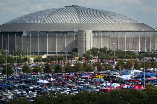 The Astrodome is seen behind the blue parking lot  full of tailgaters before an NFL football game between Houston Texans and the New York Giants at Reliant Stadium, Saturday, Oct. 9, 2010, in Houston.  (Smiley N. Pool / Houston Chronicle)