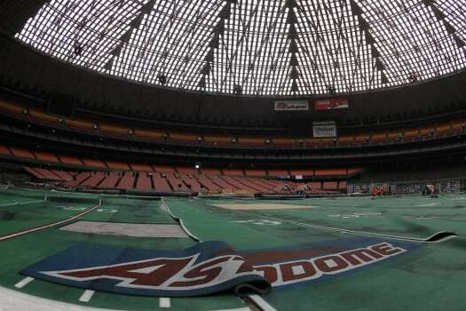 Damaged Astro Turf is stretched across the floor inside of Reliant Astrodome Tuesday, April 3, 2012, in Houston.  (Melissa Phillip / Houston Chronicle)