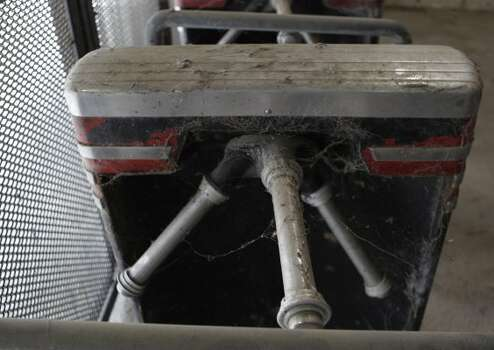Cobweb covered turnstile seen at Reliant Astrodome Tuesday, April 3, 2012, in Houston.  (Melissa Phillip / Houston Chronicle)