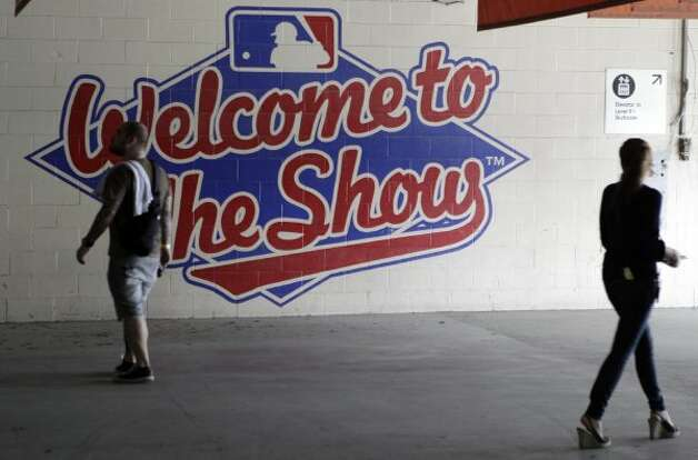People walk past a Major League Baseball wall display during a tour inside the Reliant Astrodome Tuesday, April 3, 2012, in Houston. (Melissa Phillip / Houston Chronicle)