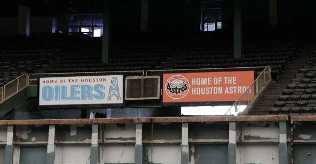 Houston Oilers and Houston Astros signs are seen inside of Reliant Astrodome Tuesday, April 3, 2012, in Houston.  The two signs were reportedly placed close together for a movie that was filmed in the Astrodome. (Melissa Phillip / Houston Chronicle)