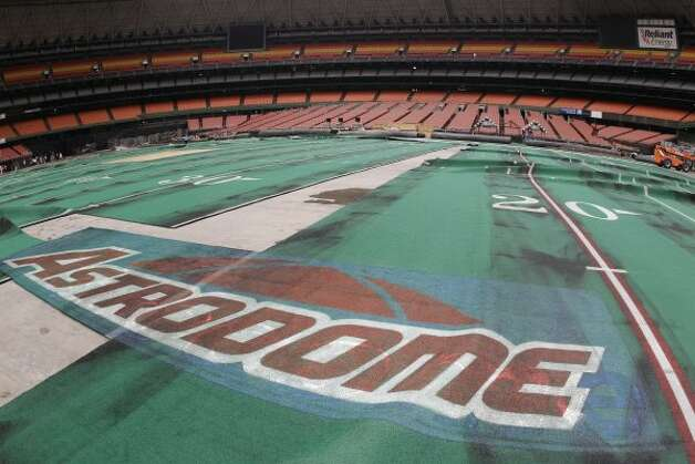 Damaged Astro Turf is seen stretched across the floor inside of Reliant Astrodome Tuesday, April 3, 2012, in Houston.  (Melissa Phillip / Houston Chronicle)