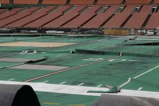 Damaged Astro Turf is seen stretched across the floor of Reliant Astrodome Tuesday, April 3, 2012, in Houston.  (Melissa Phillip / Houston Chronicle)