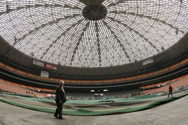 Mark Miller, left, general manger of Reliant Park, lead a media tour of the Reliant Astrodome Tuesday, April 3, 2012, in Houston.  (Melissa Phillip / Houston Chronicle)