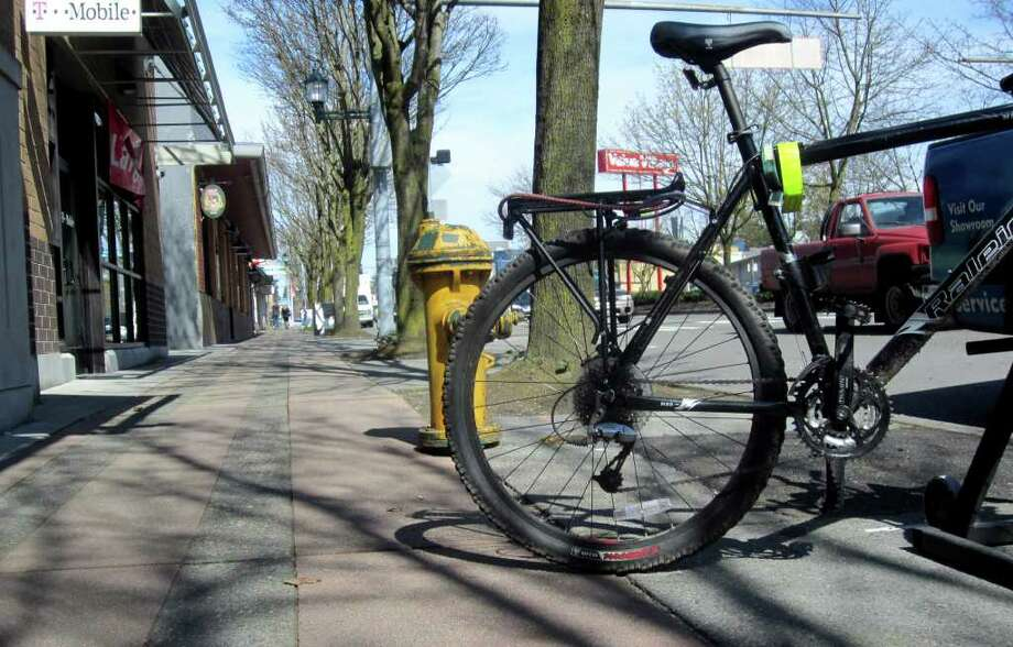 The Kaffeeklatsch bike rack creates a problem for firefighters and some pedestrians, Department of Transportation staff says. Owners of the coffee shop say it's not a problem and want the rack to stay. Photo: Casey McNerthney/seattlepi.com