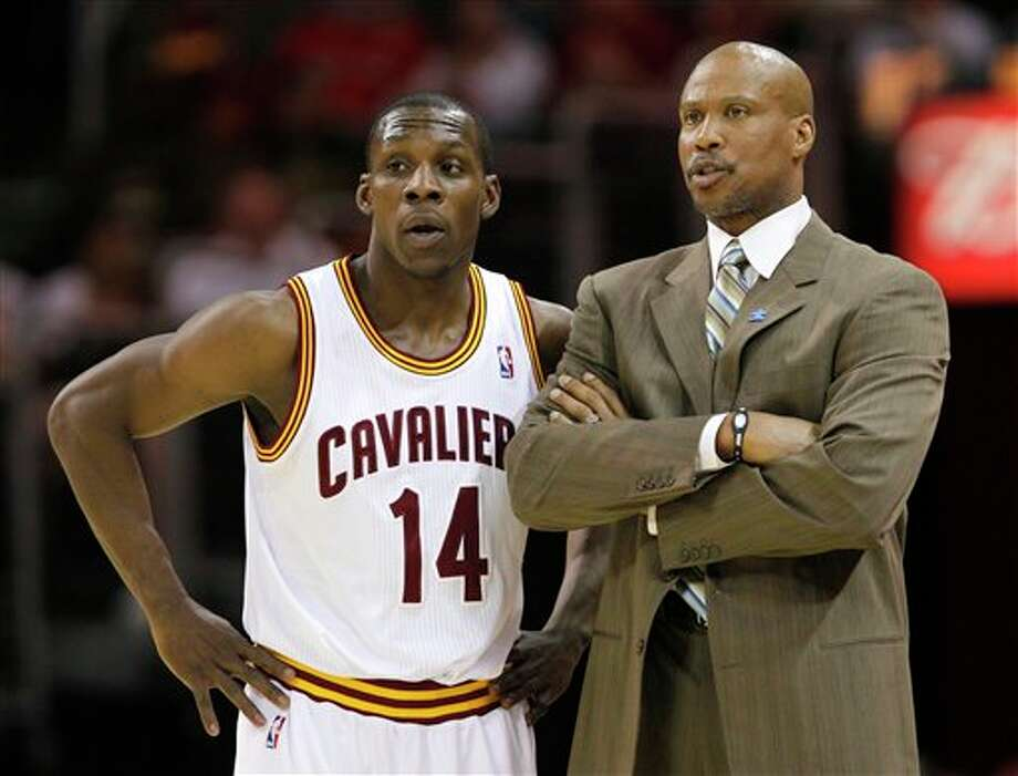Cleveland Cavaliers' Lester Hudson (14) talks with coach Byron Scott in the first half of an NBA basketball game against the San Antonio Spurs in Cleveland on Tuesday, April 3, 2012. (AP Photo/Amy Sancetta) (AP)