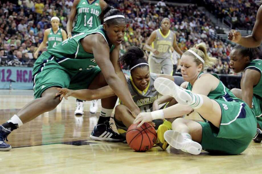 Notre Dame forward Markisha Wright (34) Baylor guard Odyssey Sims (0) Notre Dame guard Brittany Mallory (22) battle for control of the ball during the second half in the NCAA Women's Final Four college basketball championship game in Denver, Tuesday, April 3, 2012.  (AP Photo/=Name=) Photo: =Name=, Associated Press / =Source=