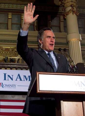 Republican presidential candidate, former Massachusetts Gov. Mitt Romney greets the crowd at a primary election night rally in Milwaukee, Tuesday, April 3, 2012, after he won the Wisconsin Republican presidential primary. (AP Photo/Steven Senne) Photo: Steven Senne