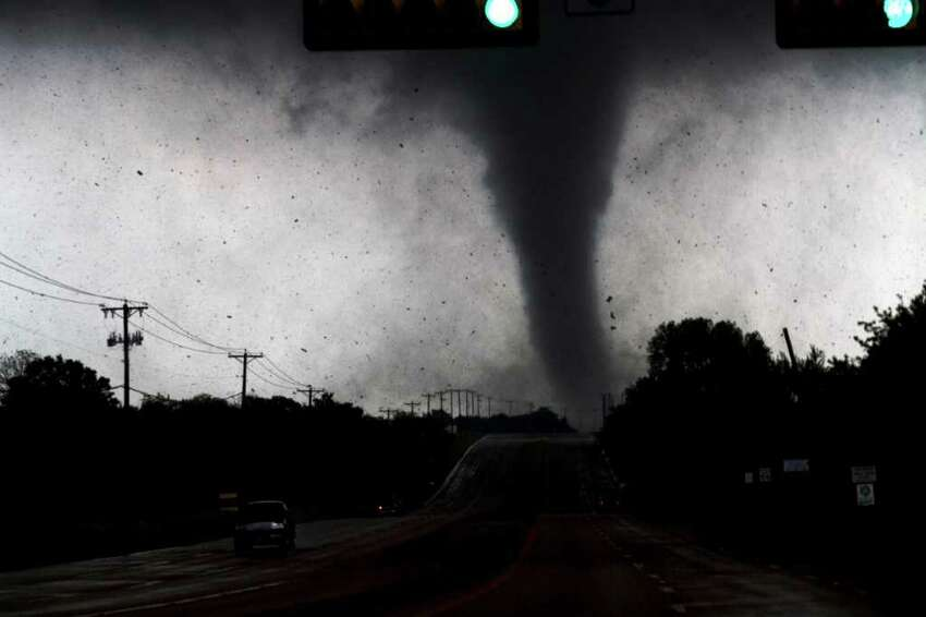 A tornado touches down in Lancaster, Texas south of Dallas on Tuesday, April 3, 2012. Tornadoes tore through the Dallas area Tuesday, peeling roofs off homes, tossing big-rig trucks into the air and leaving flattened tractor trailers strewn along highways and parking lots.
