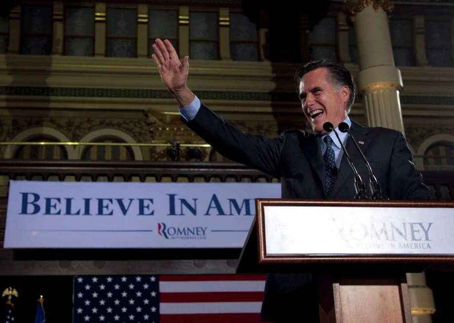 Wisconsin Republican primary winner Mitt Romney greets the crowd at Tuesday night in Milwaukee. Photo: Steven Senne / AP