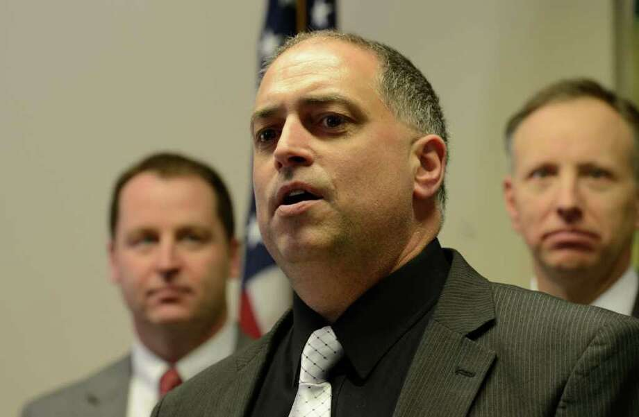 Lt. John Catone of the Saratoga Springs Police Department announces the arrest of 15 people related to a counterfeit Driver's License operation at a press conference in City Hall in Saratoga Springs, N.Y. April 3, 2012.   Lt. Catone was joined by Saratoga County District Attorney James Murphy and officials from the  NYS Department of Motor Vehicles.   (Skip Dickstein / Times Union) Photo: SKIP DICKSTEIN / 00017077A