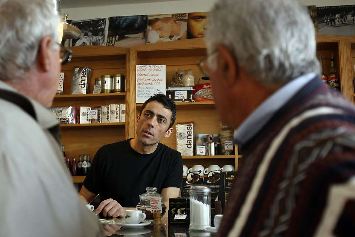 Santo Esposito (center) serves Italian coffee and famous Italian pastries to his customers at Cavalli Cafe in North Beach San Francisco, CA on April 3, 2012. He is not allowed to prepare any warm food at the shop or have tables outside as the rest of the restaurants in the North Beach area do.