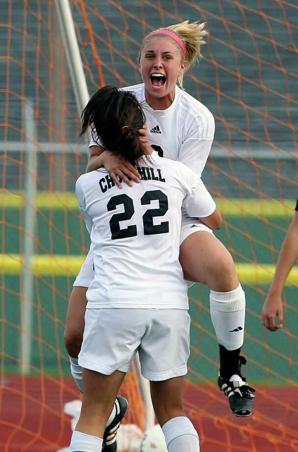 Churchill's Lauren Peck is hugged by teammate Ashley Morales after scoring first as Churchill plays Steele in boys and girls playoff soccer at Comalander Stadium on  April 3, 2012.  Tom Reel/ San Antonio Express-News Photo: TOM REEL, Express-News / San Antonio Express-News