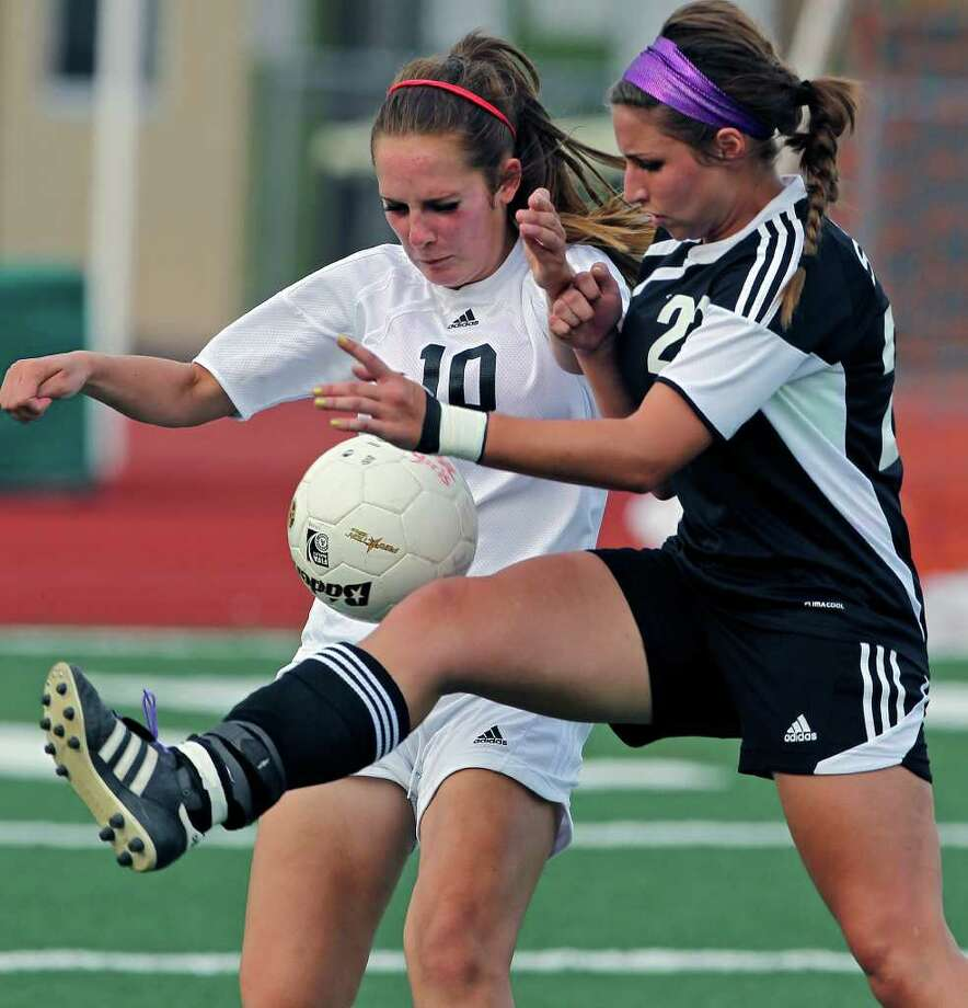 Churchill's Zayne Saadi (10) and Steele's Lauren Head (23) battle as Churchill plays Steele in boys and girls playoff soccer at Comalander Stadium on  April 3, 2012.  Tom Reel/ San Antonio Express-News Photo: TOM REEL, Express-News / San Antonio Express-News