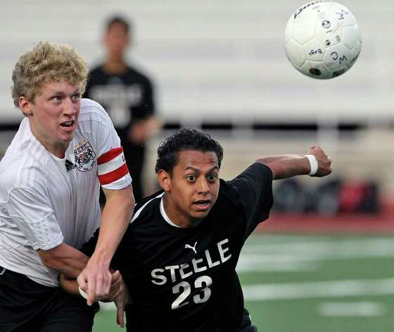 Churchill's Zach Berger (left) holds back Jonathan Medina as Churchill plays Steele in boys and girls playoff soccer at Comalander Stadium on  April 3, 2012.  Tom Reel/ San Antonio Express-News Photo: TOM REEL, Express-News / San Antonio Express-News