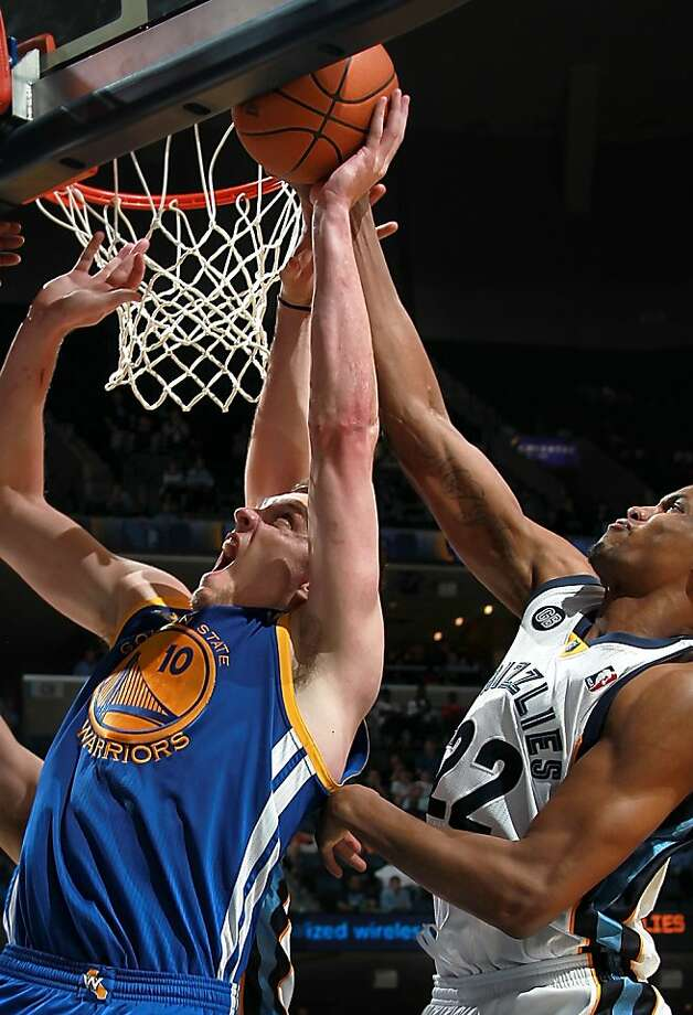 Golden State Warriors center David Lee (10) has his shot blocked by Memphis Grizzlies forward Rudy Gay (22) in the second half of an NBA basketball game Tuesday, April 3, 2012, in Memphis, Tenn. The Grizzlies defeated the Warriors 98-94. Lee led the scoring for the Warriors with 22 points. (AP Photo/Nikki Boertman) Photo: Nikki Boertman, Associated Press