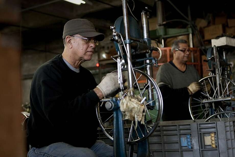Employees adjust spokes inside tire rims at the Worksman Cycles production facility in the Queens borough of New York, U.S., on Monday, March 26, 2012. The U.S. Census Bureau is scheduled to release durable goods data on March 28. Photographer: Scott Eells/Bloomberg Photo: Scott Eells, Bloomberg