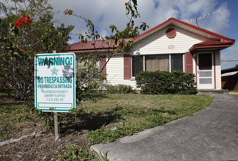"In this Friday, March 16, 2012 photo, a ""No Trespassing"" sign is shown in front of a house in Lake Worth, Fla. Thrashed by the mortgage and foreclosure disaster, Florida has thousands of distressed properties. But figuring out just how many is not so simple. Each month, analysts issue reports detailing the number of homes nationwide in foreclosure or held by banks. The implication is that if we can just find a cure for these loans and homes, either by matching buyers with houses or helping the borrowers stay put , the economy will at last be able to heal. (AP Photo/Wilfredo Lee) Photo: Wilfredo Lee, Associated Press"