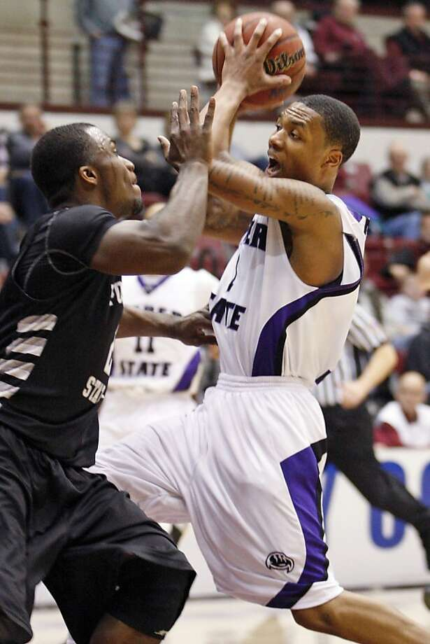 Weber State guard Damian Lillard (1) looks to make a pass under the basket in front of Portland State guard Charles Odum (2) during the second half  of an NCAA college Big Sky Tournament basketball game in Missoula, Mont., on Tuesday, March 6, 2012.(AP Photo/ Michael Albans) Photo: Michael Albans, Associated Press
