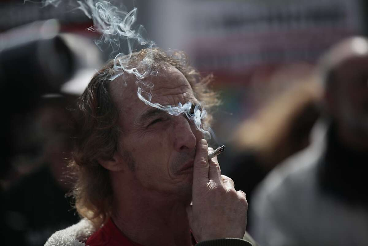 Tony DeRenzo of San Francisco smokes a marijuana cigarette during a rally at San Francisco City Hall speaking out against the federal crackdown on medical cannabis dispensaries and showing support for medical cannabis patients on Tuesday, April 3, 2012 in San Francisco, Calif. DeRenzo has Hepatitis C and is a medical marijuana patient.
