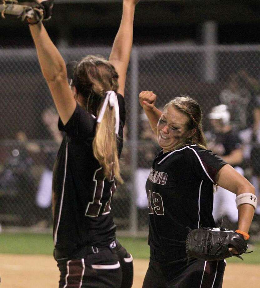 Pearland's Kristen Cuyos, left, and Haley Beam received great satisfaction from Tuesday's win. Photo: Thomas B. Shea / © 2012 Thomas B. Shea