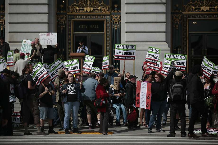 Demonstrators are seen at a rally and press conference on the steps of San Francisco City Hall  speaking out against the federal crackdown on medical cannabis dispensaries and showing support for medical cannabis patients on Tuesday, April 3, 2012 in San Francisco, Calif. Photo: Lea Suzuki, The Chronicle
