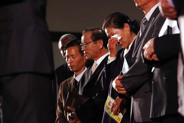 Pastor Soo Nam Sung, professor at the Oikos University wipes her tears during a memorial, Tuesday April 3, 2012, for her students that were killed in yesterdays rampage in Oakland, Calif.  Hundreds gathers at the Allen Temple Baptist Church to pay their respect. Photo: Lacy Atkins, The Chronicle