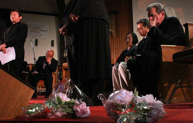 Mayor Jean Quan sits in the middle of clergy as they pray at the memorial  for the seven people killed in yesterday rampage at Oikos University, Tuesday April 3, 2012, in Oakland, Calif.  Hundreds gathers at the Allen Temple Baptist Church to pay their respect. Photo: Lacy Atkins, The Chronicle