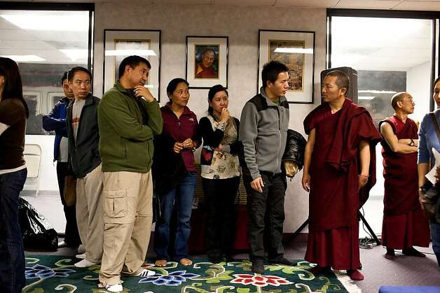 Tibetan Buddhists mourn inside the Tibetan Community Center of Richmond during a vigil for Sonam Choendon, 33, who was killed during Monday's shooting at Oikos University, Tuesday April 3, 2012 in Richmond, Calif.  Jason Henry/Special to The Chronicle Photo: Jason Henry, Special To The Chronicle