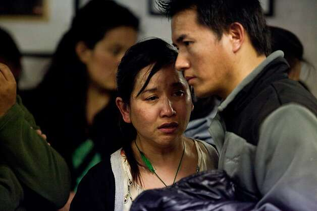 Tsering Hlazon, who was friends with Sonam Choendon, 33, who was killed during Monday's shooting at Oikos University, cries during a vigil in her memorial at the Tibetan Community Center of Richmond Tuesday April 3, 2012 in Richmond, Calif.  Jason Henry/Special to The Chronicle Photo: Jason Henry, Special To The Chronicle