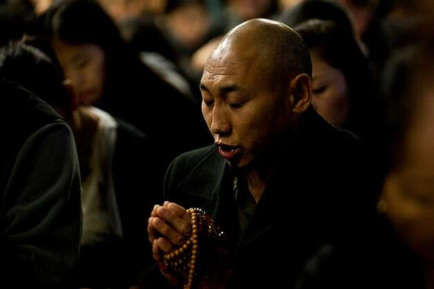 A Tibetan Buddhist chants at the Tibetan Community Center of Richmond during a vigil for Sonam Choendon, 33, who was killed during Monday's shooting at Oikos University, Tuesday April 3, 2012 in Richmond, Calif.  Jason Henry/Special to The Chronicle Photo: Jason Henry, Special To The Chronicle