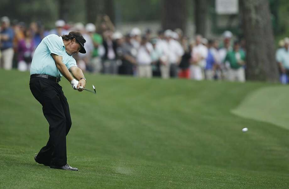 Phil Mickelson hits on the 13th fairway during a practice round for the Masters golf tournament Tuesday, April 3, 2012, in Augusta, Ga. (AP Photo/Matt Slocum) Photo: Matt Slocum, Associated Press