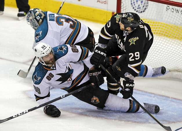 Dallas Stars center Steve Ott (29) tumbles over San Jose Sharks defenseman Brent Burns (88) and goalie Antti Niemi (31), of Finland, during the second period of  a NHL hockey game on Tuesday, April 3, 2012, in Dallas. Photo: John F. Rhodes, Associated Press