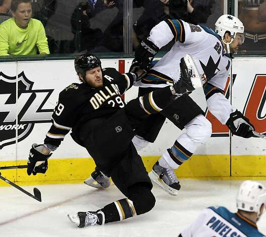 Dallas Stars center Steve Ott (29) gets upended by San Jose Sharks defenseman Dan Boyle (22) during the third period of a NHL hockey game, Tuesday, April 3, 2012, in Dallas. San Jose won 5-2. Photo: John F. Rhodes, Associated Press