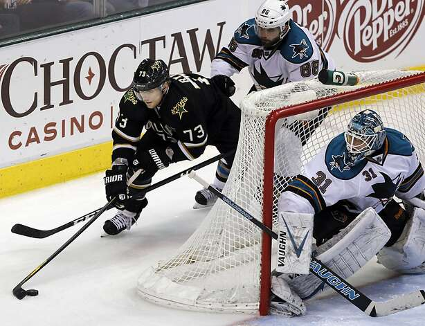 Dallas Stars right wing Michael Ryder (73) works the puck behind the goal as San Jose Sharks goalie Antti Niemi (31), of Finland, and defenseman Brent Burns (88) defend during the third period of a NHL hockey game on Tuesday, April 3, 2012, in Dallas. San Jose won 5-2. Photo: John F. Rhodes, Associated Press