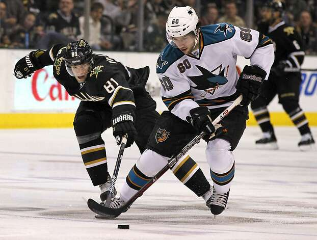 San Jose Sharks defenseman Jason Demers (60) intercepts a pass, as Dallas Stars center Tomas Vincour (81), of the Czech Republic, lunges in to try to gain control of the puck during the first period of a NHL hockey game, Tuesday, April 3, 2012, in Dallas. Photo: John F. Rhodes, Associated Press