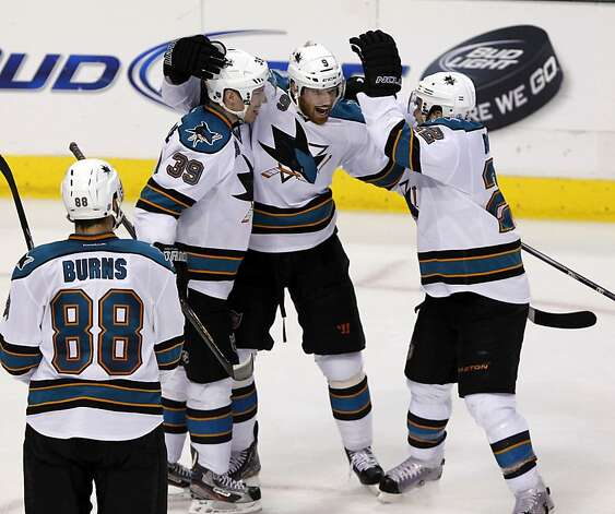 San Jose Sharks defenseman Brent Burns (88), center Logan Couture (39), right wing Martin Havlat (9), of the Czech Republic, and defenseman Dan Boyle (22) celebrate the team's third goal of the game during the second period of  a NHL hockey game against the Dallas Stars on Tuesday, April 3, 2012, in Dallas. Photo: John F. Rhodes, Associated Press