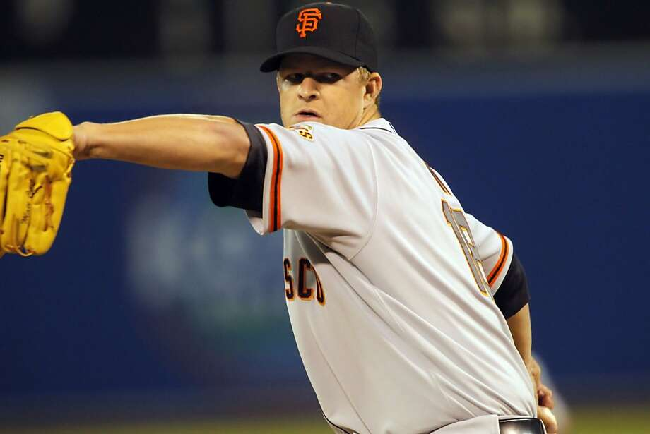 Giants starting pitcher Matt Cain starts against the Oakland Athletics in Oakland, Calif., on Tuesday, April 3, 2012, the day after it was announced that he had his contract extended. Photo: Carlos Avila Gonzalez, The Chronicle