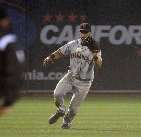 Angel Pagan fields a shallow fly ball in the 6th inning. The Oakland Athletics played the San Francisco Giants in Oakland, Calif., on Tuesday, April 3, 2011. Photo: Carlos Avila Gonzalez, The Chronicle