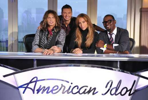 American Idol judges (left-to-right) Steven Tyler, Ryan Seacrest, Jennifer Lopez and Randy Jackson.  (Fox)