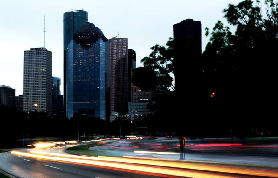 Traffic makes its way in and out of downtown along Allen Parkway on an overcast morning. (Johnny Hanson/Chronicle)
