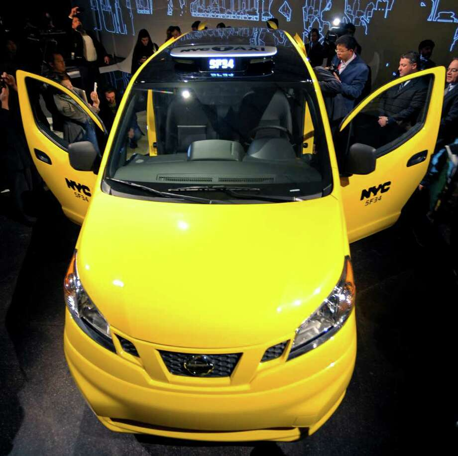 The Nissan Motor Co. NV200 Taxi stands during an exclusive preview in New York, U.S., on Tuesday, April 3, 2012. After a two-year competitive bid selection process the New York City Taxi and Limousine Commission (TLC) chose the Nissan NV200 Taxi in May 2011 as the cab of New York City beginning in late 2013. Photographer: Peter Foley/Bloomberg Photo: Peter Foley, Bloomberg / © 2012 Bloomberg Finance LP