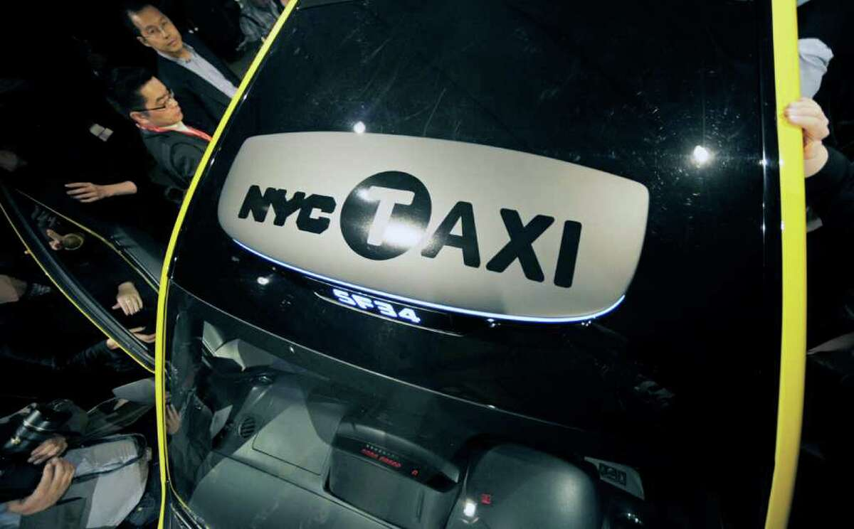The Nissan Motor Co. NV200 Taxi stands during an exclusive preview in New York, U.S., on Tuesday, April 3, 2012. After a two-year competitive bid selection process the New York City Taxi and Limousine Commission (TLC) chose the Nissan NV200 Taxi in May 2011 as the cab of New York City beginning in late 2013. Photographer: Peter Foley/Bloomberg