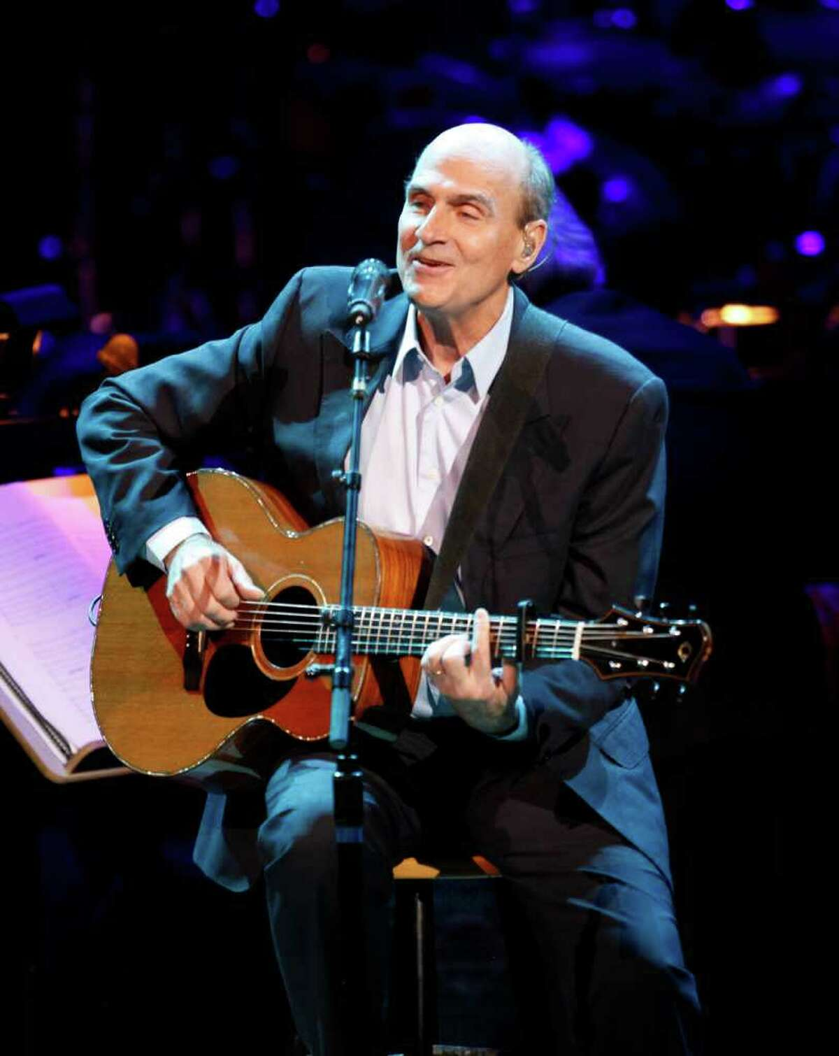 James Tayor performs during the Revlon Concert for the Rainforest Fund at Carnegie Hall, Tuesday, April 3, 2012 in New York.