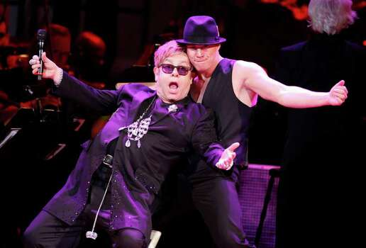 Elton John, left, and actor Channing Tatum perform together during the Revlon Concert for the Rainforest Fund at Carnegie Hall, Tuesday, April 3, 2012 in New York. Photo: Jason DeCrow, AP / FR103966 AP