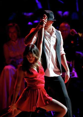 Actor Channing Tatum and his wife Jenna Dewan Tatum perform together as Meryl Steep and Sting watch from the background during the Revlon Concert for the Rainforest Fund at Carnegie Hall, Tuesday, April 3, 2012 in New York. Photo: Jason DeCrow, AP / FR103966 AP